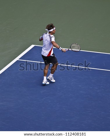 NEW YORK - SEPTEMBER 9: David Ferer of Spain returns ball during semifinal match against Novak Djokovic of Serbia at US Open tennis tournament on September 9, 2012 in Flushing Meadows New York