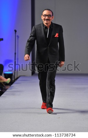 NEW YORK- SEPTEMBER 17: Designer Arcadio Diaz walks runway at the Arcadio Diaz show at Waldorf Astoria for S/S 2013 during Couture Fashion Week on September 17, 2012 in New York City, NY