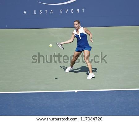 NEW YORK - SEPTEMBER 1: Dominika Cibulkova of Slovakia returns ball during 3rd round match against Roberta Vinci of Italy at US Open tennis tournament on September 1, 2012 in Flushing Meadows New York