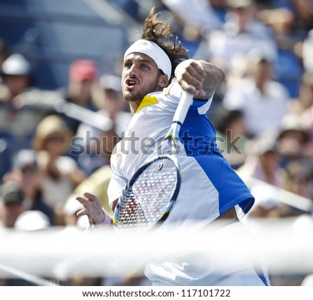 NEW YORK - SEPTEMBER 1: Feliciano Lopez of Spain returns ball during 3rd round match against Andy Murray of United Kingdom at US Open tennis tournament on September 1 2012 in Flashing Meadows New York