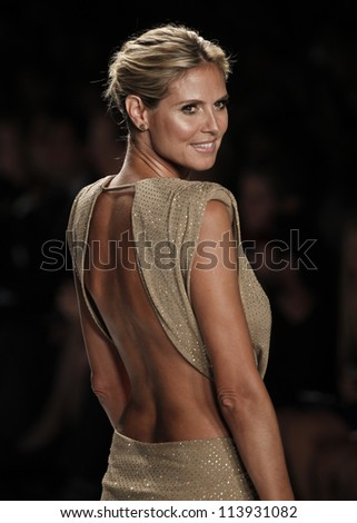 NEW YORK - SEPTEMBER 07: Heidi Klum  walks the runway for Project Runway Collection during Spring/Summer 2013 at Mercedes-Benz Fashion Week on September 07, 2012 in New York