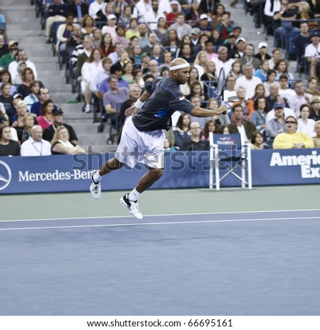 NEW YORK - SEPTEMBER 04: James Blake of USA returns a ball during match against Novak Djokovic of Serbia at US Open Tennis Championship on September 04, 2010 in New York, City.