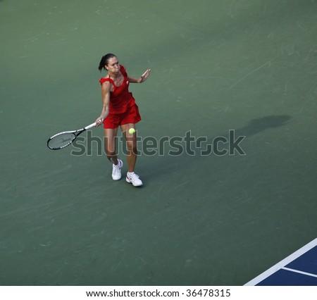 NEW YORK - SEPTEMBER  3: Jelena Jankovic of Serbia returns a shot during 2nd round match against Yaroslava Shvedova of Kazakhstan at US Open on September 3, 2009 in New York.