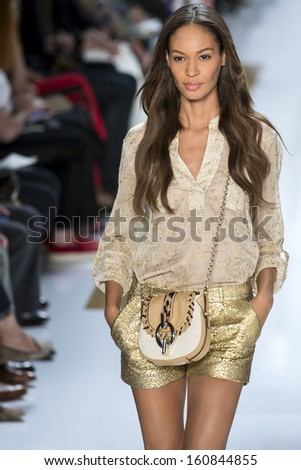 NEW YORK SEPTEMBER 08 Joan Smalls is walking the runway at Diane Von Furstenberg Collection for Spring Summer 2014 fashion show during Mercedes-Benz Fashion Week on SEPTEMBER 08 2013 in New York