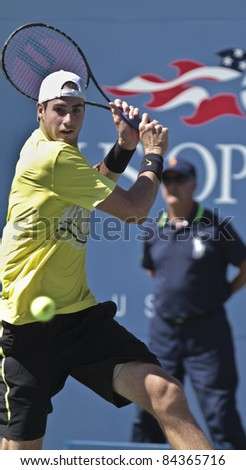 NEW YORK - SEPTEMBER 09: John Isner of USA returns ball during quarterfinal match against Andy Murray of Scotland at USTA Billie Jean King National Tennis Center on September 09, 2011 in NYC