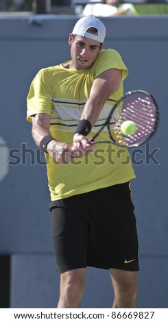 NEW YORK - SEPTEMBER 09: John Isner of USA returns ball during quarterfinal match against Andy Murray of Scotland at USTA Billie Jean King National Tennis Center on September 09, 2011 in New York City, NY