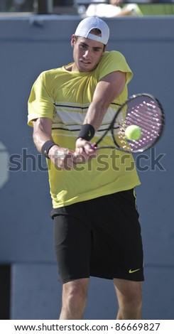 NEW YORK - SEPTEMBER 09: John Isner of USA returns ball during quarterfinal match against Andy Murray of Scotland at USTA Billie Jean King National Tennis Center on September 09, 2011 in New York City, NY
