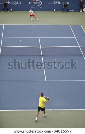 NEW YORK - SEPTEMBER 04: Juan Martin Del Porto returns ball during 3rd round match against Gilles Simon of France at USTA Billie Jean King National Tennis Center on September 03, 2011 in NYC