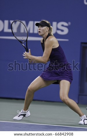 NEW YORK - SEPTEMBER 02: Maria Sharapova of Russia returns a ball during match against Iveta Benesova of Czech Republic and  at US Open Tennis Championship on September 02, 2010 in New York, City.