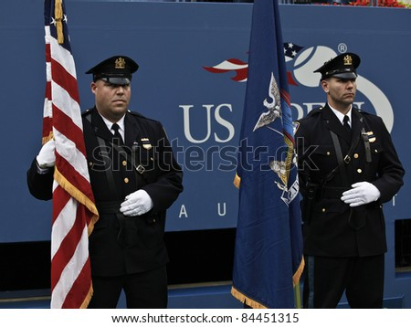 NEW YORK - SEPTEMBER 11: Members of Fire Department of New York on court during 9/11 ceremony at USTA Billie Jean King National Tennis Center on September 11, 2011 in NYC