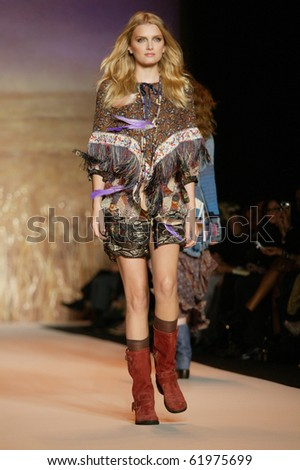 NEW YORK - SEPTEMBER 15: Model Lily Donaldson walks the runway at the Anna Sui collection presentation for Spring/Summer 2011 during Mercedes-Benz Fashion Week on September 15, 2010 in New York