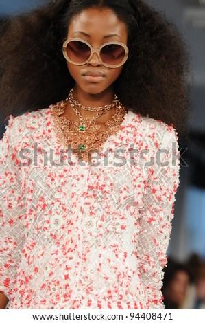 NEW YORK - SEPTEMBER 13: Model walks the runway at the Oscar De La Renta Spring/Summer 2012 collection during New York Fashion Week on September 13, 2011 in New York City.