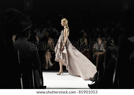 NEW YORK - SEPTEMBER 10: Model walks the runway at the SUPIMA Spring / Summer 2012 collection presentation during Mercedes-Benz Fashion Week on September 10, 2011 in New York.