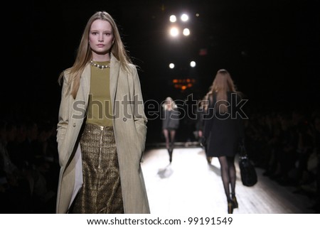 NEW YORK - SEPTEMBER 13: Model walks the runway at the Theyskens' Theory S/S 2012 collection presentation during Mercedes-Benz Fashion Week on September 13, 2011 in New York. - stock photo