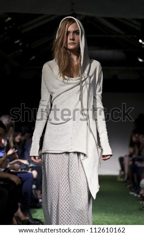 NEW YORK - SEPTEMBER 11: Model walks the runway for Lars Andersson Collection during Spring/Summer 2013 at Mercedes-Benz Fashion Week in Grand Soho Yard on September 11, 2012 in New York