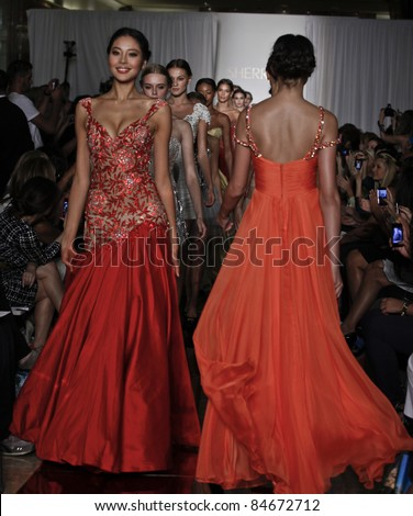 NEW YORK - SEPTEMBER 14: Models walk runway for collection by Sherri Hill at Mercedes-Benz Spring/Summer 2012 Fashion Week in Trump Tower on September 14, 2011 in New York City