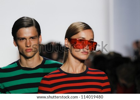 NEW YORK - SEPTEMBER 12: Models walk the runway at the Michael Kors S/S 2013 collection presentation during Mercedes-Benz Fashion Week on September 12, 2012 in New York.