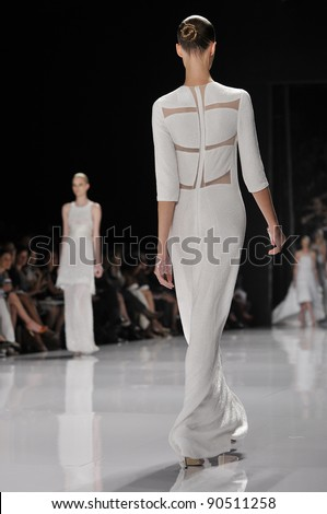 NEW YORK - SEPTEMBER 13: Models walk the runway at the Narciso Rodriguez Spring / Summer 2012 collection presentation during Mercedes-Benz Fashion Week on September 13, 2011 in New York City, NY