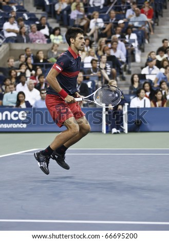 NEW YORK - SEPTEMBER 04: Novak Djokovic of Serbia returns a ball during match against James Blake of USA at US Open Tennis Championship on September 04, 2010 in New York, City.