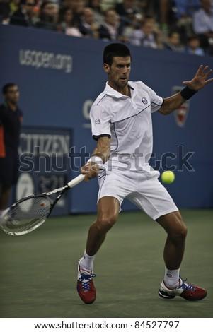 NEW YORK - SEPTEMBER 12: Novak Djokovic of Serbia returns ball during final match against Rafael Nadal of Spain at USTA Billie Jean King National Tennis Center on September 12, 2011 in NYC