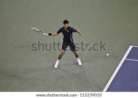 NEW YORK - SEPTEMBER 06: Novak Djokovic of Serbia returns ball during quarterfinal match against Juan Martin Del Potro of Argentina at US Open tennis tournament on September 6, 2012 in New York CIty