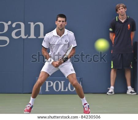 NEW YORK - SEPTEMBER 05: Novak Djokovic of Serbia returns ball during 4th round match against Alexandr Dolgopolov of Ukraine at USTA Billie Jean King National Tennis Center on September 05 2011 in NYC