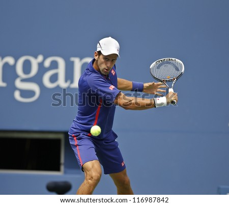 NEW YORK - SEPTEMBER 2: Novak Djokovic of Serbia returns ball during 4th round match against Julien Benneteau of France at US Open tennis tournament on September 2, 2012 in Flushing Meadows New York