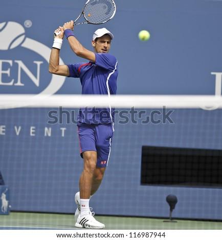 NEW YORK - SEPTEMBER 2: Novak Djokovic of Serbia returns ball during 4th round match against Julien Benneteau of France at US Open tennis tournament on September 2, 2012 in Flushing Meadows New York - stock photo