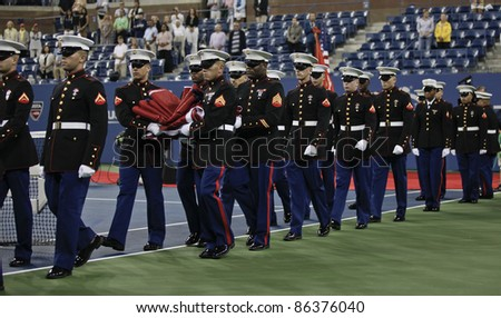 NEW YORK - SEPTEMBER 10: Opening ceremony with National Guards before semifinal match between Caroline Wozniacki of Denmark and Serena Williams of USA at US Open on September 10, 2011 in NYC