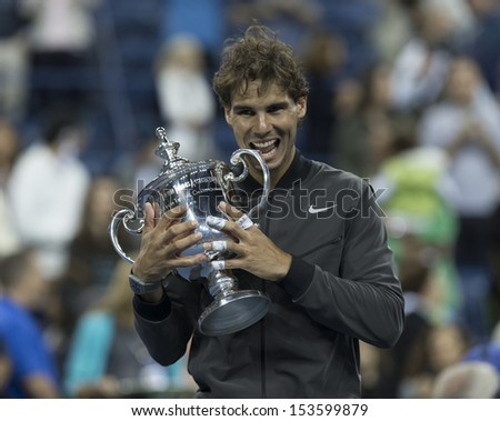 NEW YORK - SEPTEMBER 9: Rafael Nadal of Spain poses with trophy after winning final against Novak Djokovic if Serbia at USTA Billie Jean King National Tennis Center on September 9, 2013 in New York