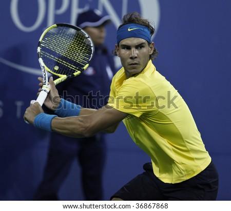 NEW YORK - SEPTEMBER 10: Rafael Nadal of Spain returns a shot during quarterfinal round match against Fernando Gonzalez of Chile at US Open on September 10 2009 in Flushing, New York.