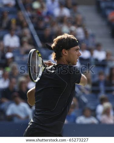 NEW YORK - SEPTEMBER 13: Rafael Nadal of Spain returns ball during final match of US Open Tennis Championship against Novak Djokovic of Serbia on September 13, 2010 in New York, City.