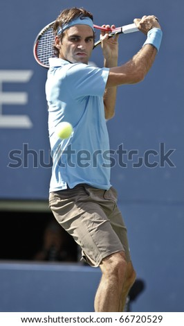 NEW YORK - SEPTEMBER 04: Roger Federer of Switzerland returns a ball during match against Paul-Henry Mathieu of France at US Open Tennis Championship on September 04, 2010 in New York, City.