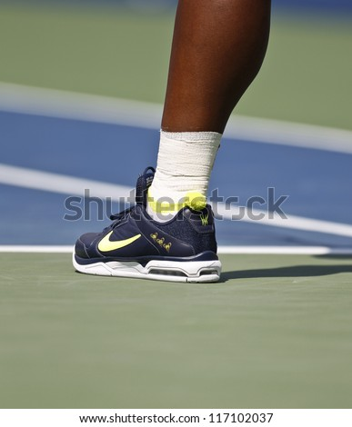 NEW YORK - SEPTEMBER 1: Serena Williams of USA wear Nike sneakers during 3rd round match against Ekaterina Makarova of Russia at US Open tennis tournament on September 2, 2012 in Flashing Meadows NYC - stock photo