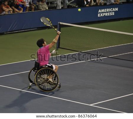 NEW YORK - SEPTEMBER 10: Sharon Walraven of Netherland returns ball during final wheelchair match against Jiske Griffioen & Aniek Koot of Netherland at US Open on September 10, 2011 in NYC