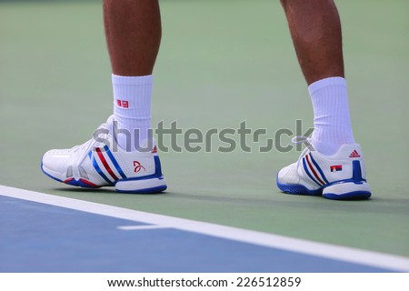 NEW YORK - SEPTEMBER 1 Six times Grand Slam champion Novak Djokovic wears custom Adidas tennis shoes during match at US Open 2014 at Billie Jean King National Tennis Center on September 1, 2014 in NY