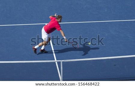 NEW YORK - SEPTEMBER 7: Stanislas Wawrinka of Switzerland returns ball at US Open semifinal match against Novak Djokovic of Serbia at USTA National Tennis Center on September 7, 2013 in New York