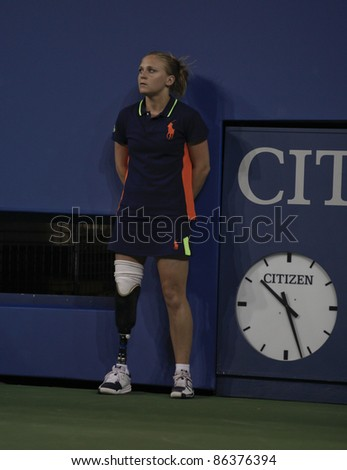 NEW YORK - SEPTEMBER 10: US Open ball person Denise Castelli of New Jersey with prosthetic leg works during match between Caroline Wozniacki of Denmark and Serena Williams of USA on Sep 10, 2011 in NYC
