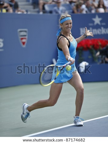 NEW YORK - SEPTEMBER 03: Victoria Azarenka of Belarus returns ball during 3rd round match against Serena Williams at US Open on September 03, 2011 in New York City.