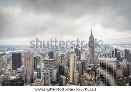New York skyline. Aerial view over Manhattan on a cloudy day #558788161