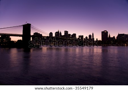 New York skyline at night with the Brooklyn bridge taken from Brooklyn