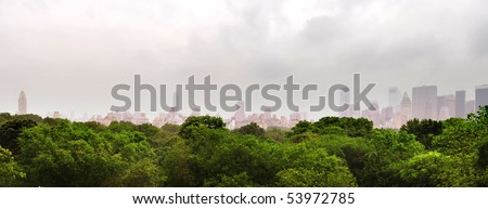 New York skyscrapers rise behind the lush green of central park #53972785