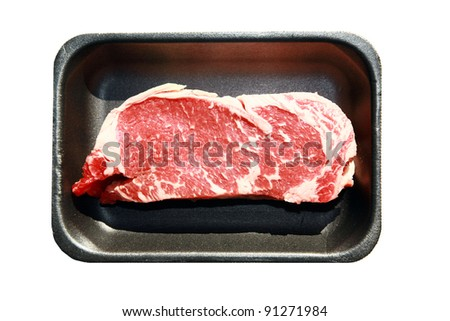 New York Steak, raw meat, on a black foam tray isolated on white with room for your text