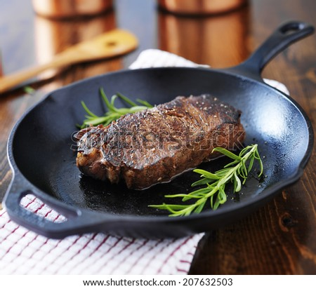new york strip steak cooked in iron skillet