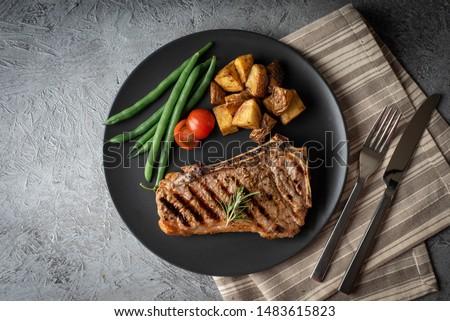 new york strip steak on concrete background #1483615823