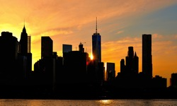 new york sunset from brooklyn side and silhouette of Manhattan skyline