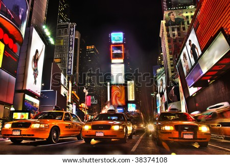 Stock Photo New York Times Square At Night. All logos and trademarks are obscured.  I am the copyright holder of all photos/art composed into the image.