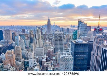 NEW YORK, UNITED STATES - DECEMBER 28, 2015 -  New York City skyline with urban skyscrapers at sunset. #492676696