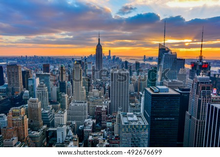 NEW YORK, UNITED STATES - DECEMBER 28, 2015 -  New York City skyline with urban skyscrapers at sunset. #492676699