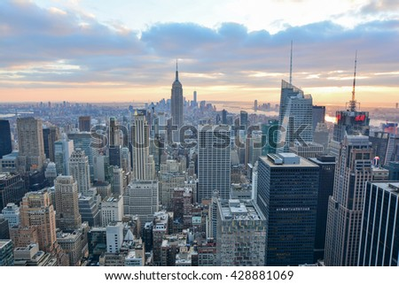 NEW YORK, UNITED STATES - DECEMBER 28, 2015 -  night view of new york city with skyscrapers and colorful lights of downtown. sunset filter used
